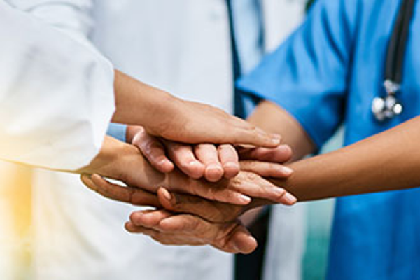 Collaborative Care Team Hands Together